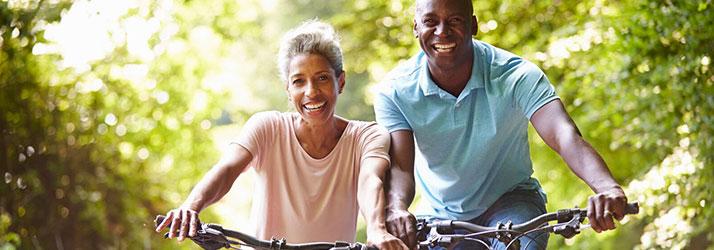 Chiropractic Roseville MN Happy Biking Couple